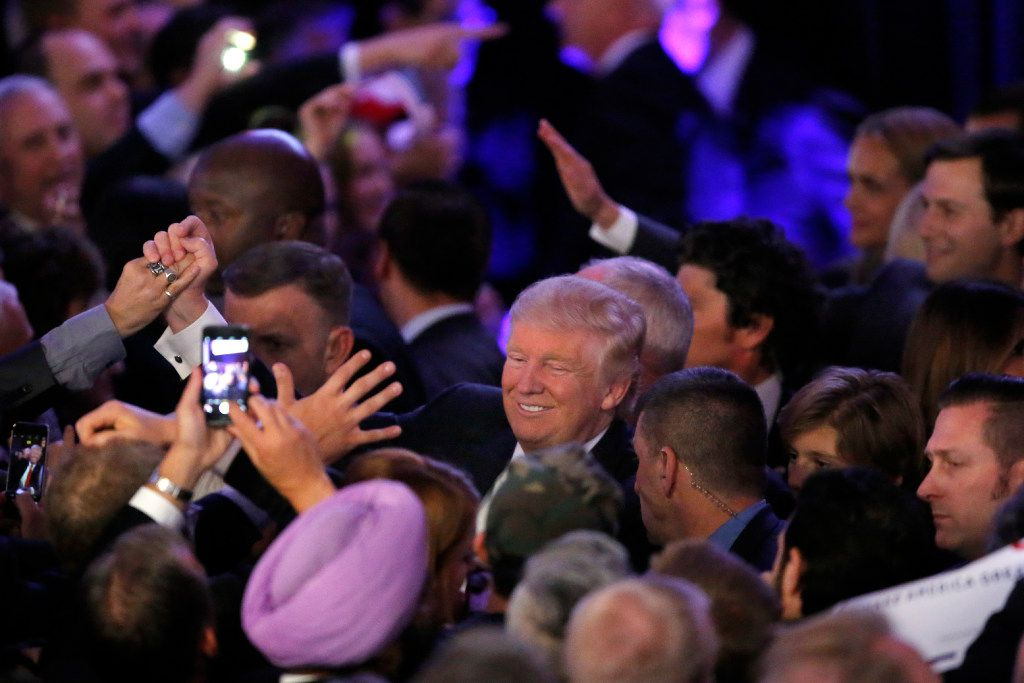 President-elect Donald Trump shakes hands with supporters after making his acceptance speech at an election party at the Midtown Hilton in New York City early on Nov. 9, 2016.