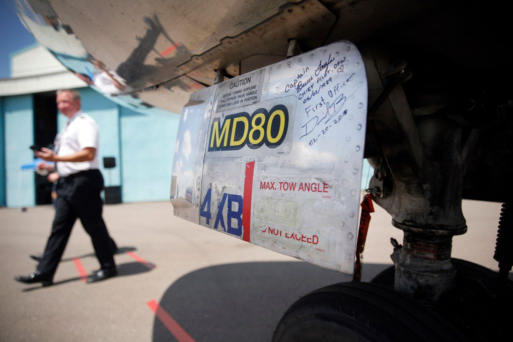 American Airlines pilots signed the nose wheel door after ferrying the MD-80 to Roswell International Air Center.