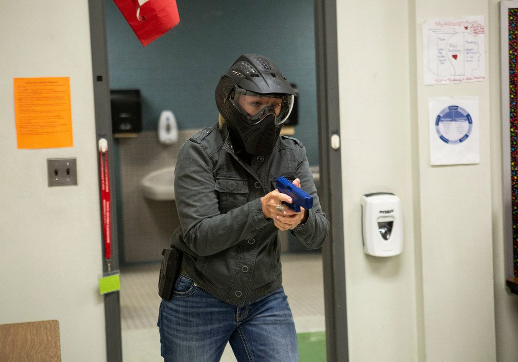 A Texas school employee training to become an armed school marshal steps into a classroom during a practice drill at Windermere Elementary School in Pflugerville, Texas on August 10, 2018. (Thao Nguyen/Special Contributor).