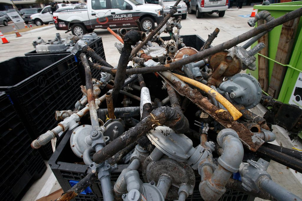 Gas meters removed from houses are stacked at a temporary headquarters in a neighborhood of northwest Dallas earlier this month. About 2,800 homes in northwest Dallas near the site of a deadly house explosion will be without gas service for as long as three weeks as Atmos Energy completely replaces gas lines.