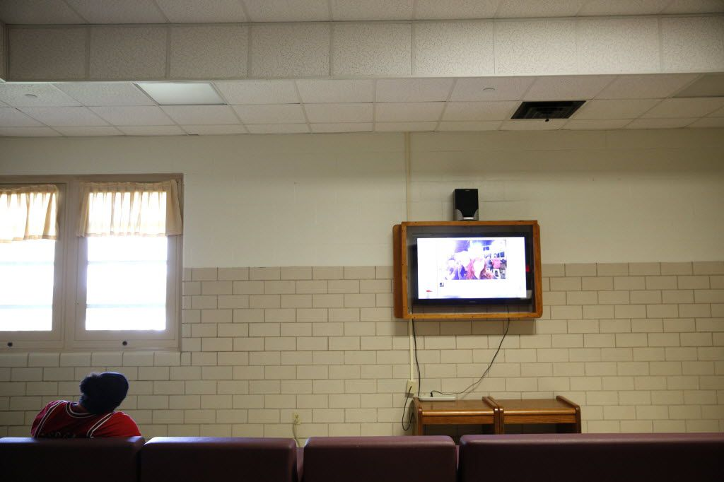 A patient watches TV in the common area of the forensic ward at the Terrell State Hospital in Terrell, Texas on April 21, 2016. (Rose Baca/The Dallas Morning News)