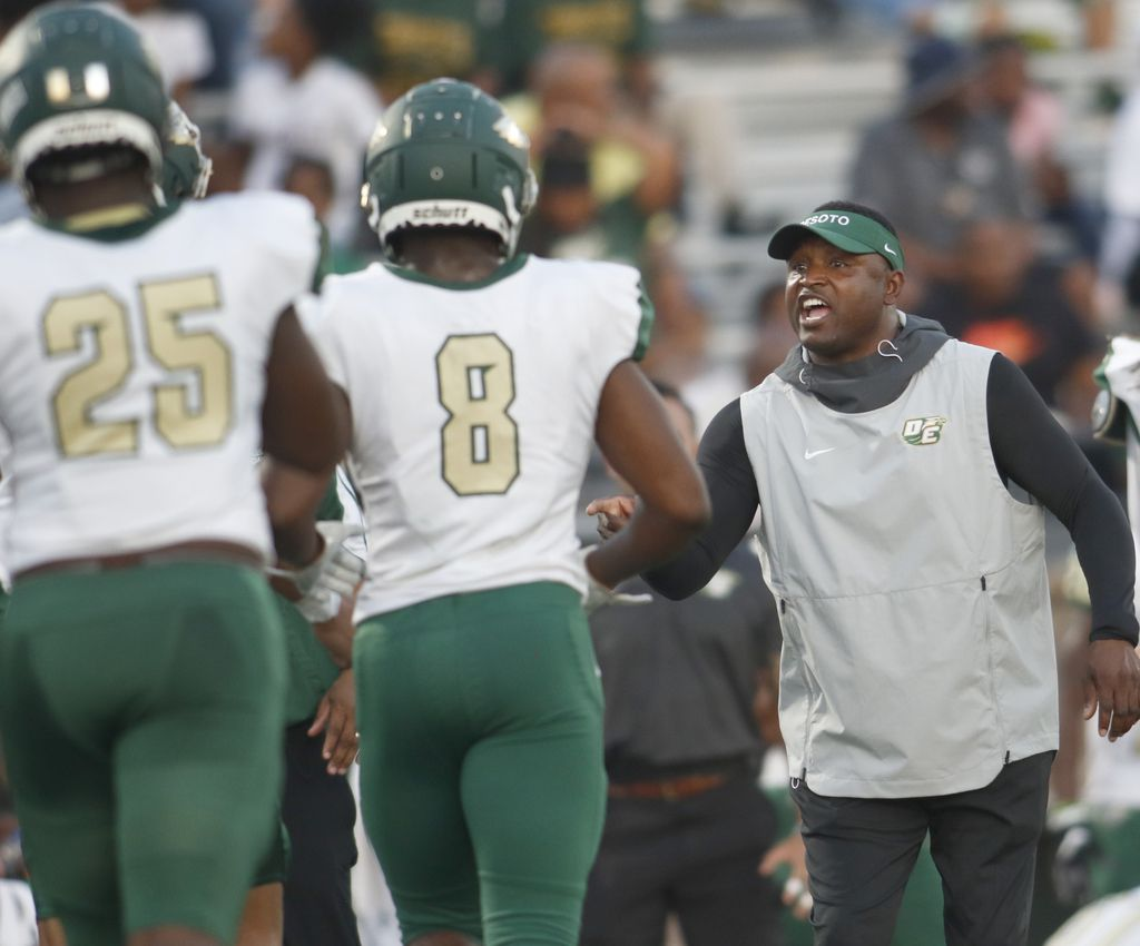 DeSoto head coach Claude Mathis congratulates Khylan Mosely (8) following an Eagles touchdown during second quarter action against Jesuit. The two teams played their non-district high school football game at Jesuit College Preparatory School in Dallas on September 6, 2019. (Steve Hamm/ Special Contributor)
