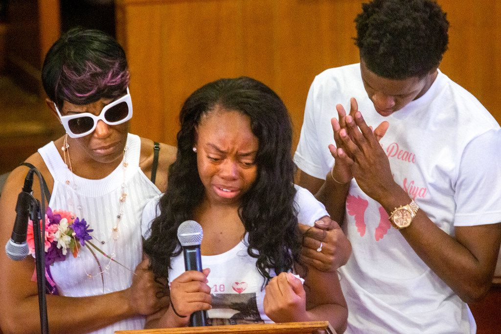 Ashton Elder (left) and Dayday Elder (right) support a family member during the funeral service for 9-year-old Brandoniya Bennett at the New Morning Star Missionary Baptist Church on Friday.