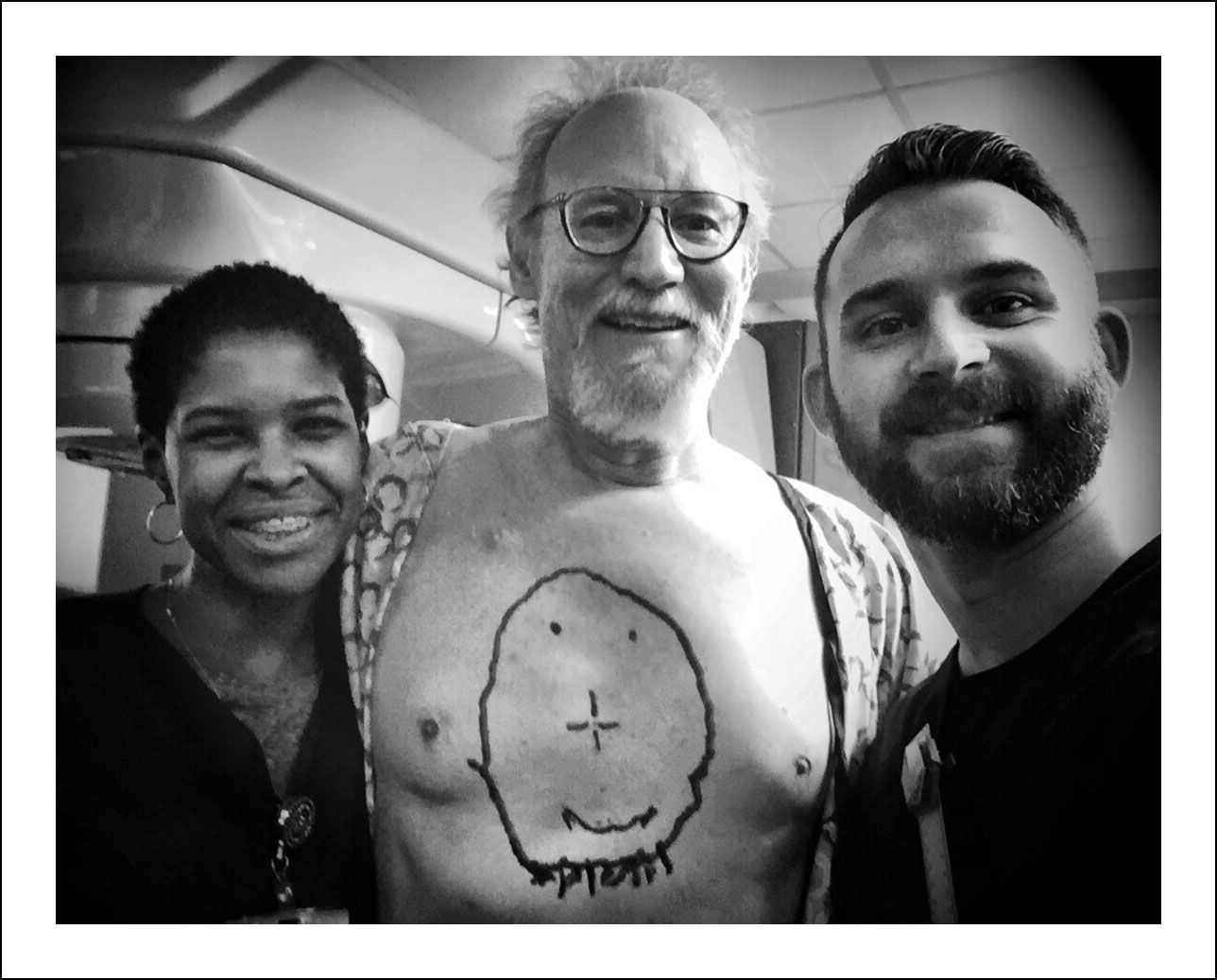 1/26/18 — Last of 15 radiology appointments today. I surprised Ramona and Rob, the super zapping duo, with a big smile. Courtney Perry suggested I draw a smiley face when she saw a previous post showing the alignment tattoos. The little dot in the center of the nose is permanent. The rest I did this morning. I know it's pretty bad because my great artist son wouldn't do it for me.