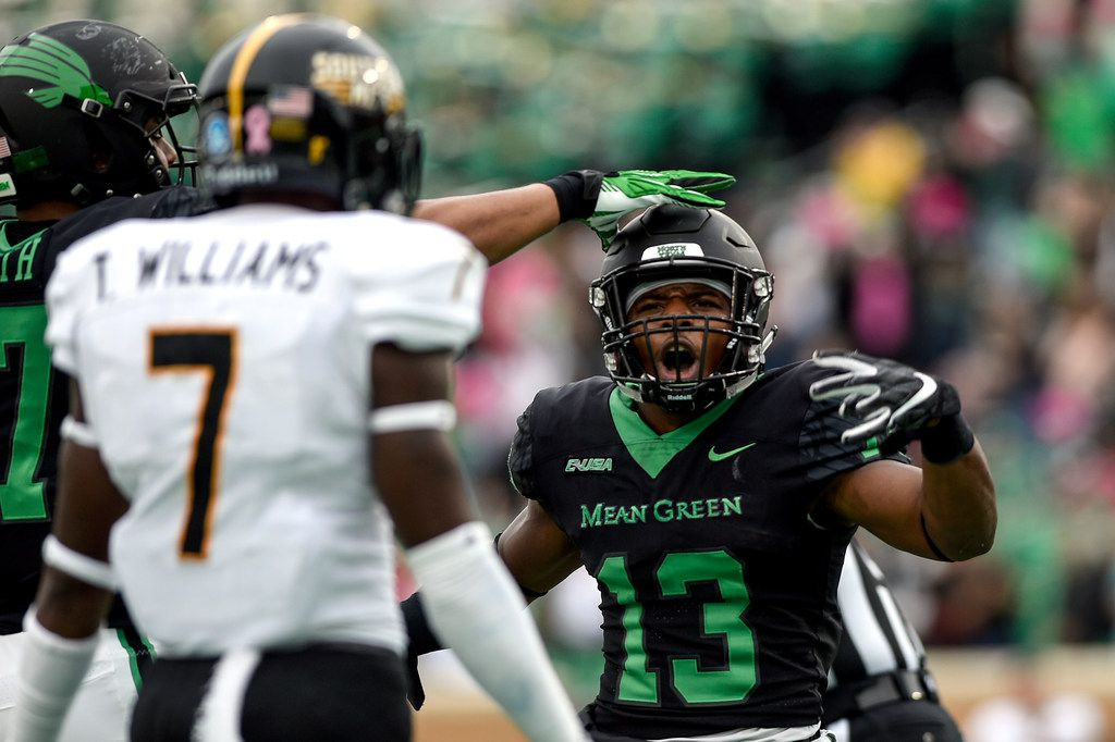 North Texas Mean Green running back DeAndre Torrey (13) taunts Southern Miss defensive back Ty Williams (7) after scoring a touchdown during the game at Apogee Stadium in Denton, Texas, on Saturday, Oct. 13, 2018.