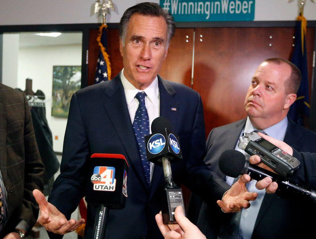 Sen. Mitt Romney, R-Utah, (left) voted against a Texas federal judge nominee on Tuesday.