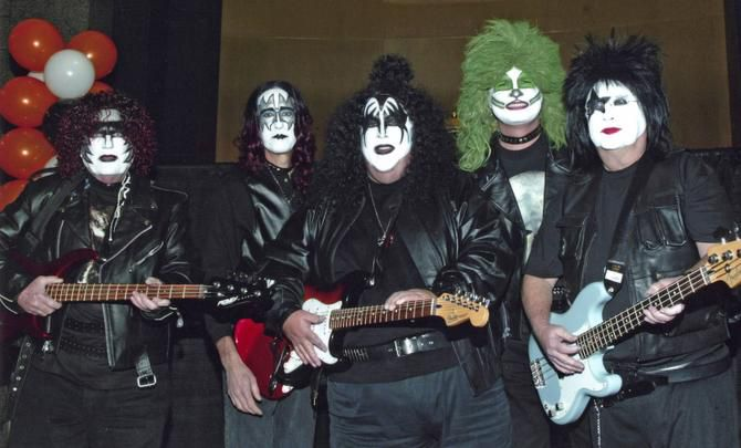 De Pierce (left), Jeff Isom, Alan White, Jerry Schaffner and George McCleskey were KISS in a 2005 companywide Halloween tour of Lubbock, Austin and Dallas. Costumes are mandatory for all 4,500 employees of PlainsCapital Corp.