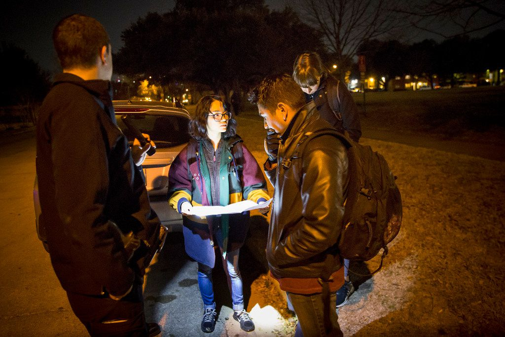 From left, Dallas police officer Kevin Kelley,  Diana Dinh, Alan Garcia and Meredith Mortberg check a map before setting off into Garrett Park for the annual homeless census on Thursday, Jan. 26, 2017, in Dallas.