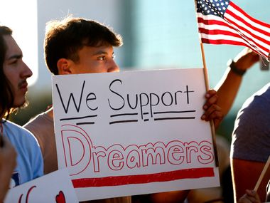 Jordin Chavez stands in the crowd with a sign during a support rally for DACA recipients at City Hall Plaza in Dallas on Wednesday, Sept. 6, 2017.