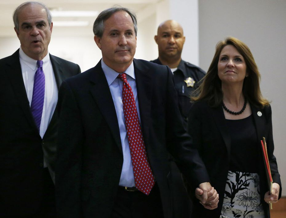 Texas Attorney General Ken Paxton and his wife, Angela, entered the Merrill Hartman Courtroom in the 5th Court of Appeals at the George Allen Courts Building in Dallas on May 12. Paxton appeared in court to fight his three felony fraud indictments. (File Photo/Rose Baca)