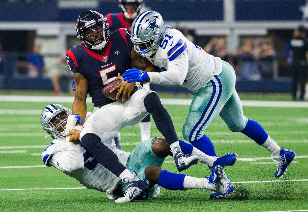 Dallas Cowboys defensive end Taco Charlton (97) and defensive end Kerry Hyder (51) sack Houston Texans quarterback Joe Webb (5) during the second quarter of an NFL game between the Dallas Cowboys and the Houston Texans on Saturday, August 24, 2019 at AT&T Stadium in Arlington.