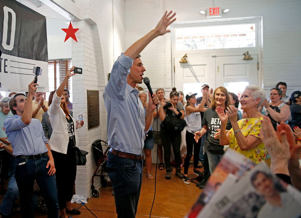 U.S. Rep. Beto O'Rourke, D-El Paso, waves to supporters during a town hall at the Historic Santa Fe Train Depot in Gainesville.