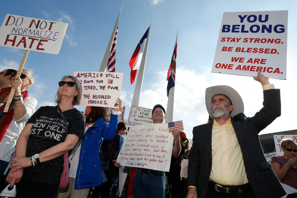 Thousands protest for immigrant and refugee communities in downtown in front of Dallas City Hall on February 18, 2017.  (Nathan Hunsinger/The Dallas Morning News)