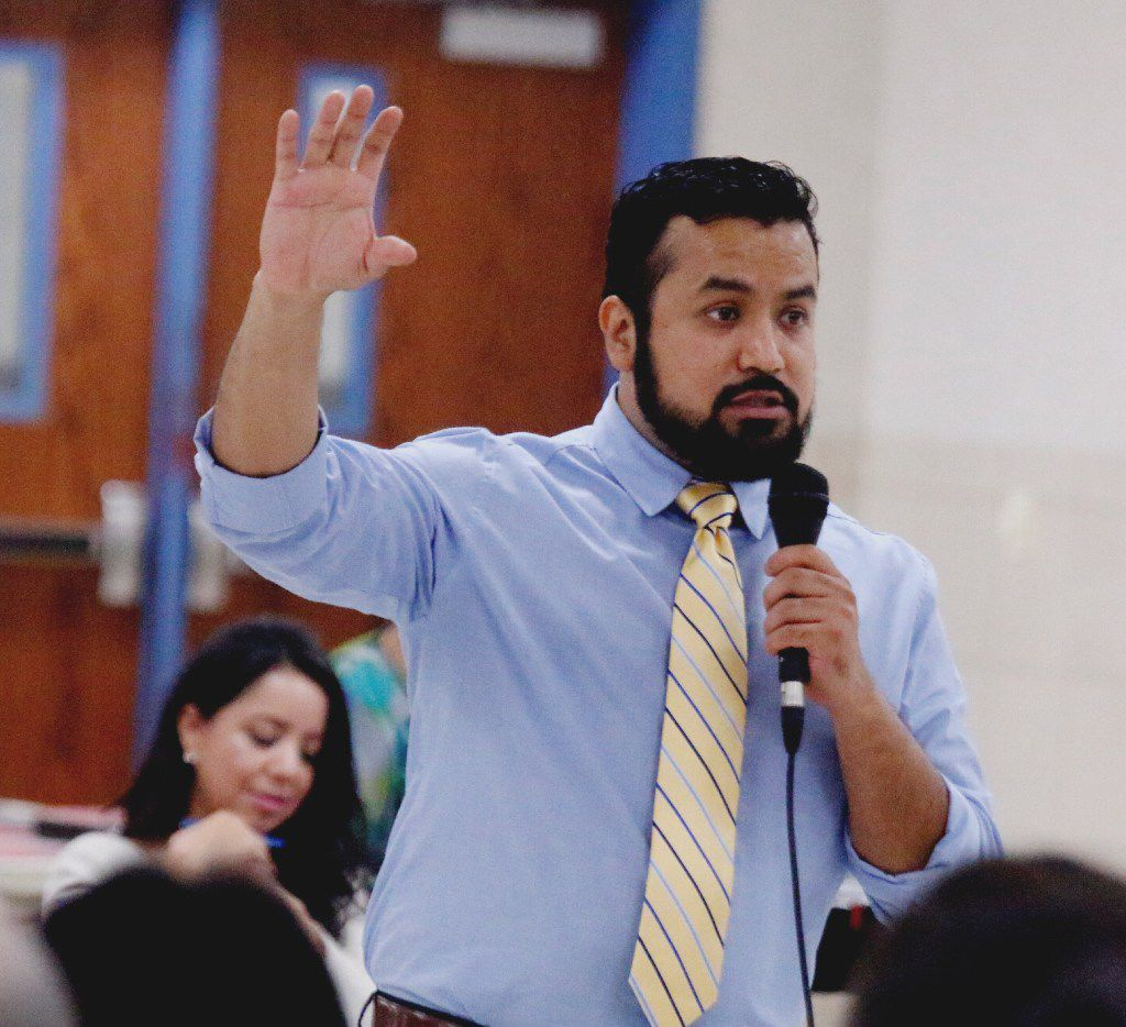 Activist Ramiro Luna urges an immigrant crowd to have hope. Hope pulled him through dark moments, such as his father's deportation when he was 13 years old, he said during an address at the Horn High School in Mesquite on Tuesday.