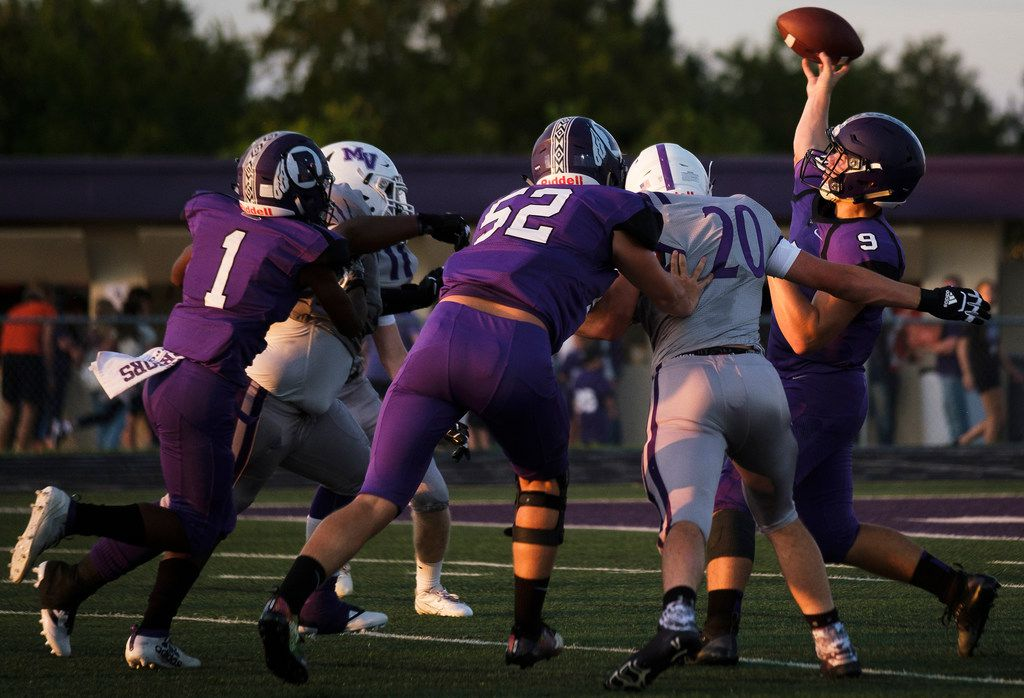 Bonham quarterback  Brant Stuber (9) throws a pass under pressure from the Mount Vernon defense during the season-opening game for both teams on Friday, Aug. 30, 2019, in Bonham, Texas. The away game against the Bonham is the first game at Mount Vernon for Art Briles, the former Baylor coach. (Smiley N. Pool/The Dallas Morning News)