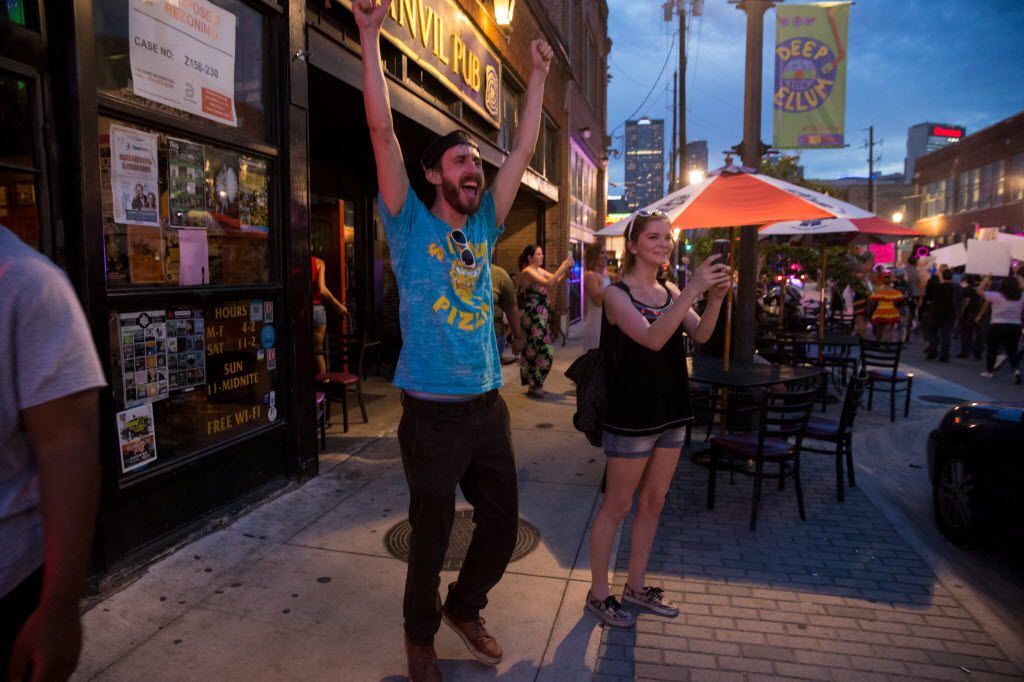 Brian McGinnis (center left), of Dallas cheers on the during the Queer Bomb Dallas procession march though in Deep Ellum streets on June 25, 2016 in Dallas. (Ting Shen/The Dallas Morning News)
