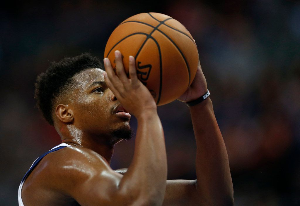 Dallas Mavericks guard Dennis Smith Jr. (1) prepares to shoot a free throw during the first half of a preseason game against the Charlotte Hornets at American Airlines Center in Dallas on Friday, October 12, 2018. (Vernon Bryant/The Dallas Morning News)