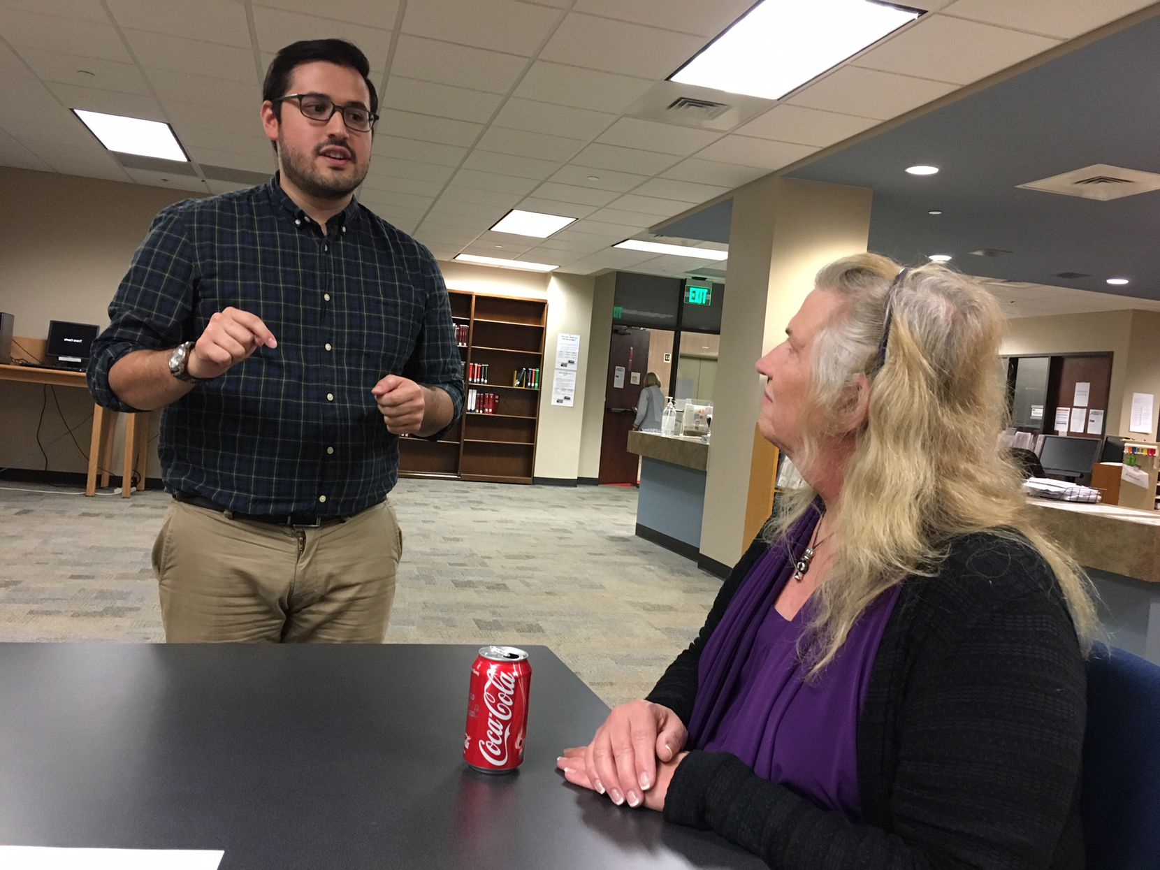 Cristian Sánchez (left) a third-year law student at the University of Texas at Austin, speaks with Claire Bow during a meeting of the Trans Name and Gender Marker Project at the Travis County Law Library. Sánchez is the pro bono scholar heading up the project. Bow is a former assistant attorney general assisting on the project.