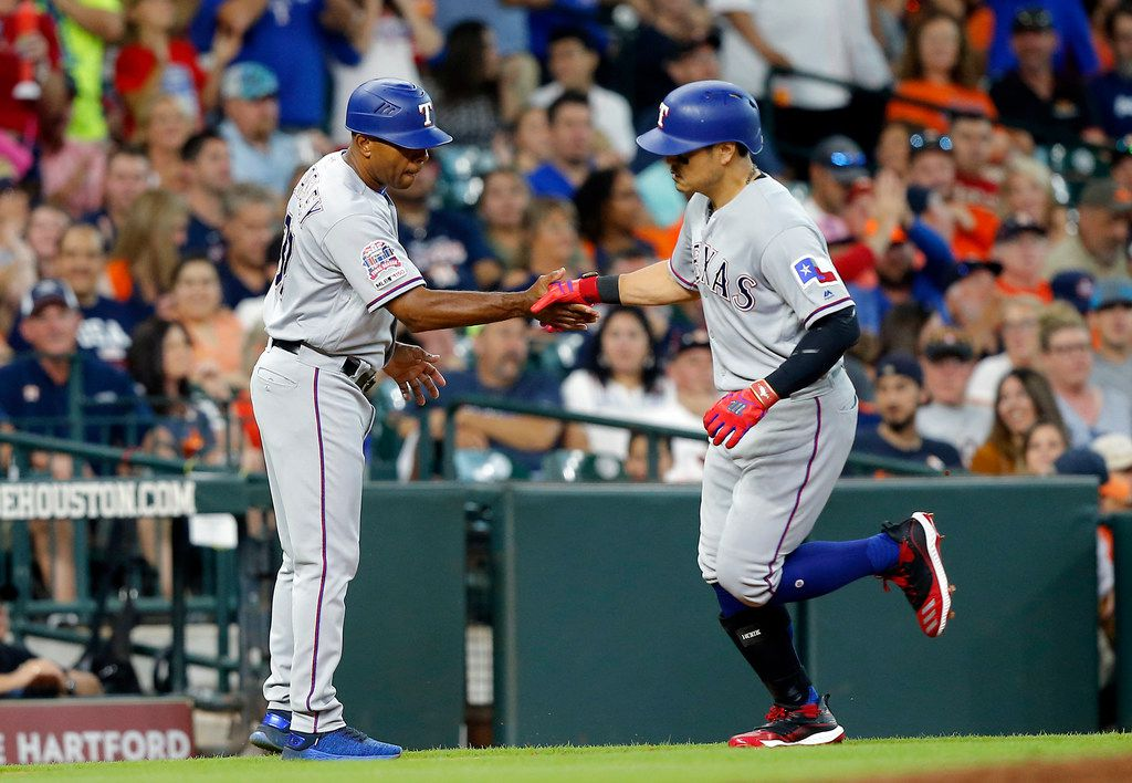 HOUSTON, TEXAS - JULY 20: Shin-Soo Choo #17 of the Texas Rangers receives congratulations from third base coach Tony beasley #27 after hitting a home run in the fourth inning at Minute Maid Park on July 20, 2019 in Houston, Texas. (Photo by Bob Levey/Getty Images)