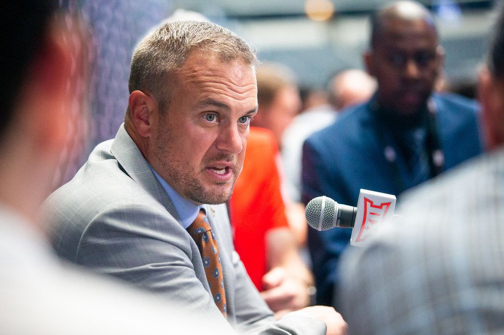 University of Texas head football coach Tom Herman speaks with reporters during the breakout session of the Big 12 Conference Media Days event at the AT&T Stadium in Arlington, Texas, Tuesday, July 16, 2019. (Lynda M. Gonzalez/The Dallas Morning News)