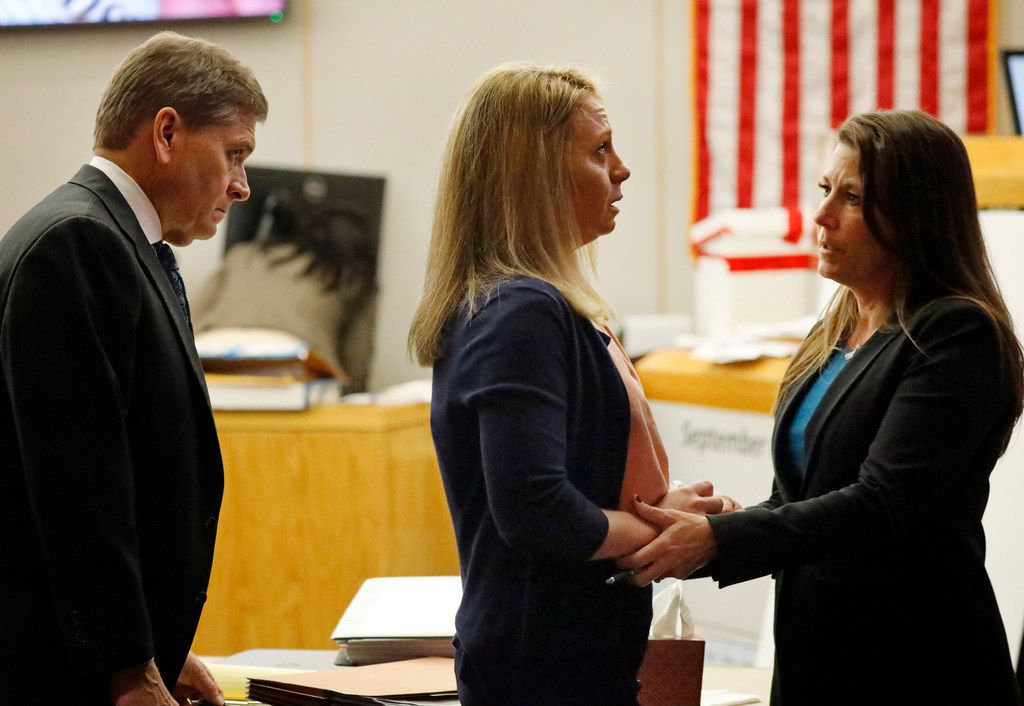 Defense counsel Shelley Shook (right) comforts Amber Guyger during a recess in her murder trial Wednesday.