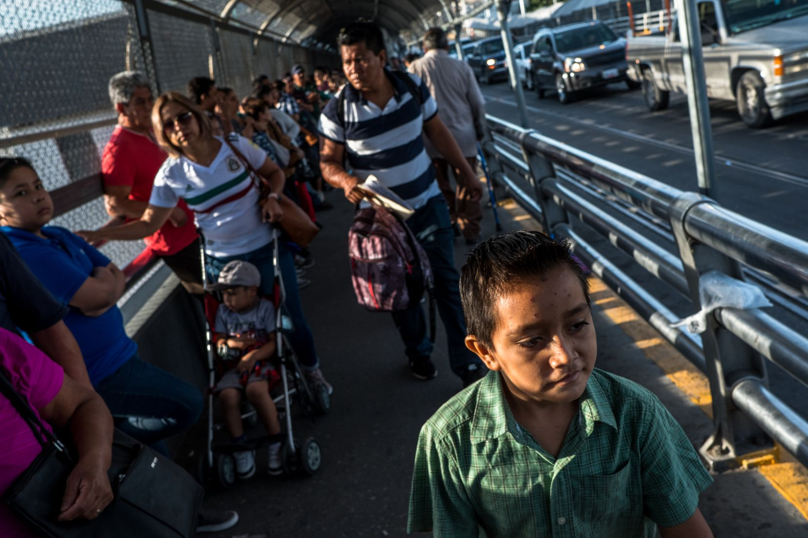 Cristopher Yovani Monjel, 7, is followed by his father, Edgar, 34, as they walk up the Paso del Norte Bridge toward a U.S. Port of Entry in Ciudad Juarez, Mexico, earlier this month. The Monjel family was attending their first immigration court date after being sent back to Mexico a month ago for the duration of their asylum case as part of the Migrant Protection Protocol program.