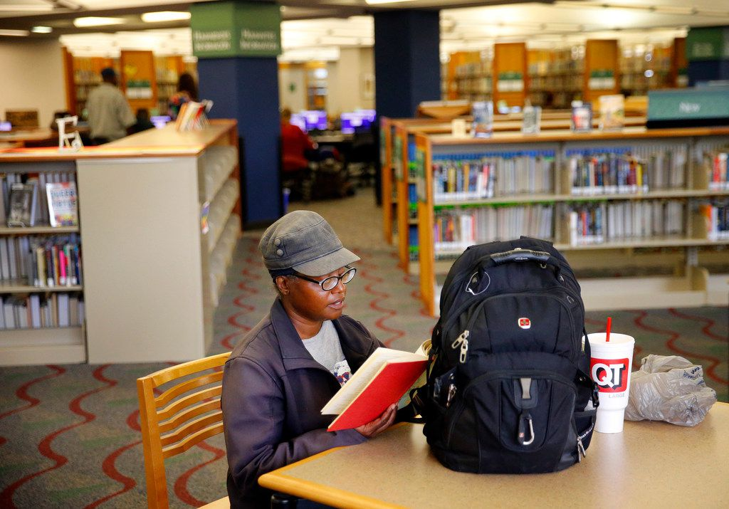 Tara Jackson likes to read books about different cultures and languages at the Dallas Central Library, where air-conditioning provides an oasis in the summer heat.