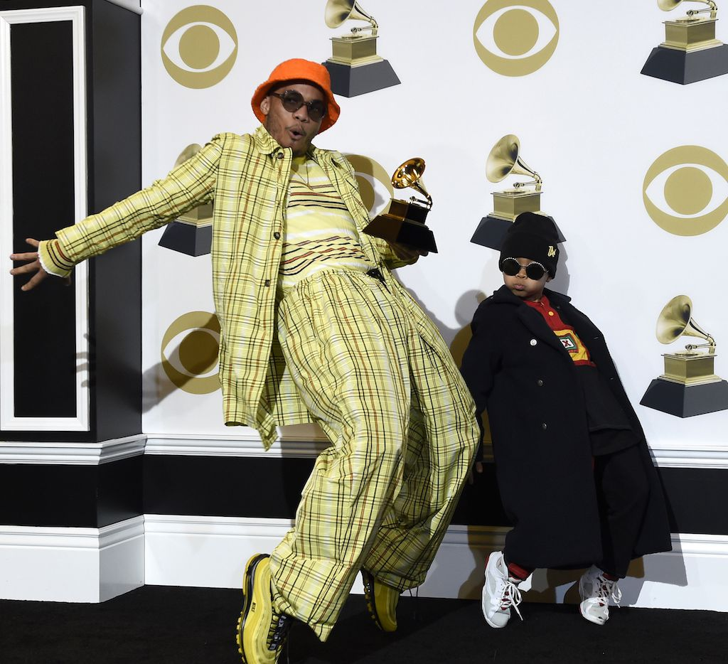 "Anderson .Paak (left) winner of the award for best rap performance for ""Bubblin"" poses with son Soul Rasheed at the 61st annual Grammy Awards at the Staples Center on Feb. 10, 2019, in Los Angeles."