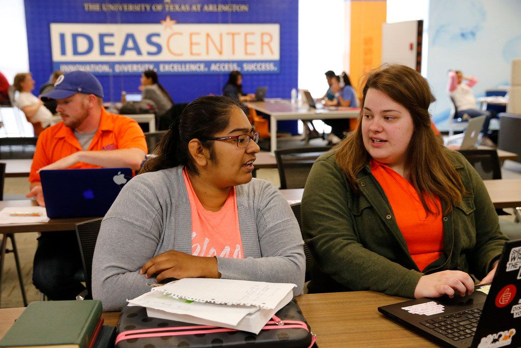 Crystal Ramirez (left), a TCC transfer gets help from peer educator, Baleigh Zurn, a Kilgore Community College transfer at the I.D.E.A.S. center inside Central Library at the University of Texas at Arlington in Arlington, Texas on Monday, April 29, 2019. UTA is a couple of years into a multi-million grant aimed at helping transfer students reach the finish line. The university's I.D.E.A.S. Center is designed with transfer students and other non-traditional students to help them through mentoring and tutoring as well as other services. (Vernon Bryant/The Dallas Morning News)