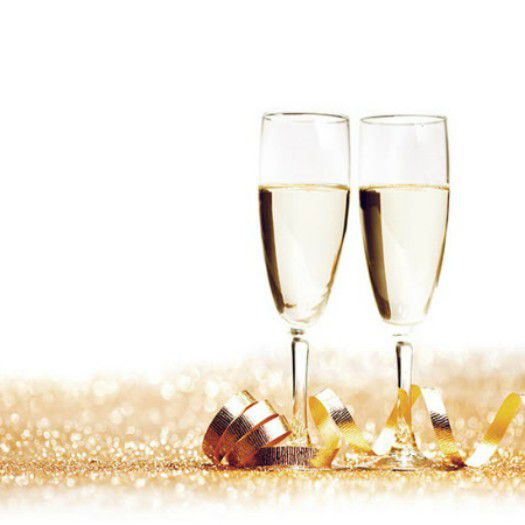 Glasses of champagne and decorative golden ribbon