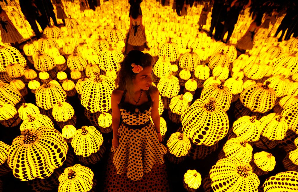 Lyza Hernandez looks at the Yayoi Kusama's installation: All the Eternal Love I Have for the Pumpkins, at the Dallas Museum of Art in Dallas in September.