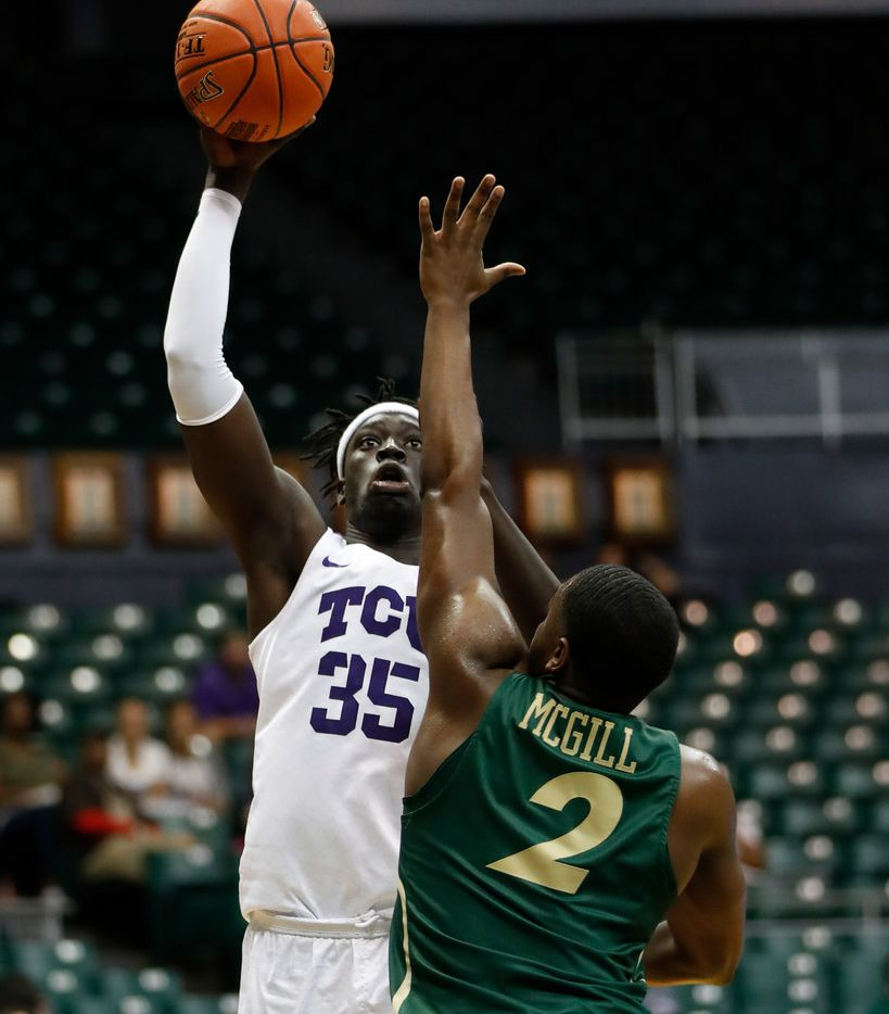 TCU forward Yuat Alok (35) shoots over Charlotte guard Jaylan McGill (2) during the second half of an NCAA college basketball game at the Diamond Head Classic, Saturday, Dec. 22, 2018, in Honolulu. (AP Photo/Marco Garcia)