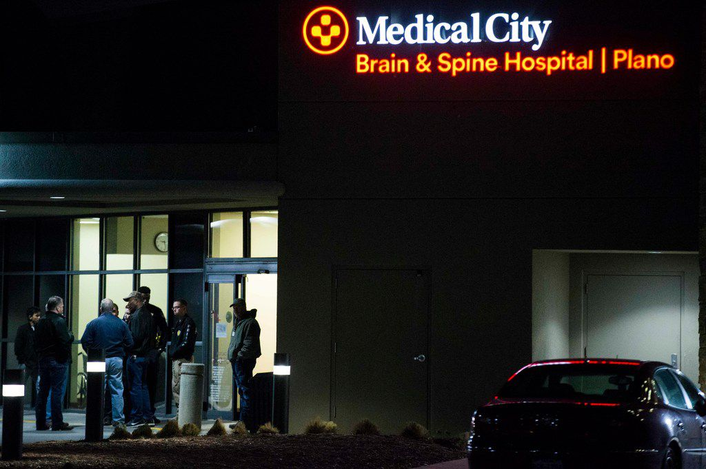 Police officers gather at the emergency room at Plano Medical City hospital after a Richardson police officer was shot on Wednesday, February 7, 2018 in Plano, Texas.