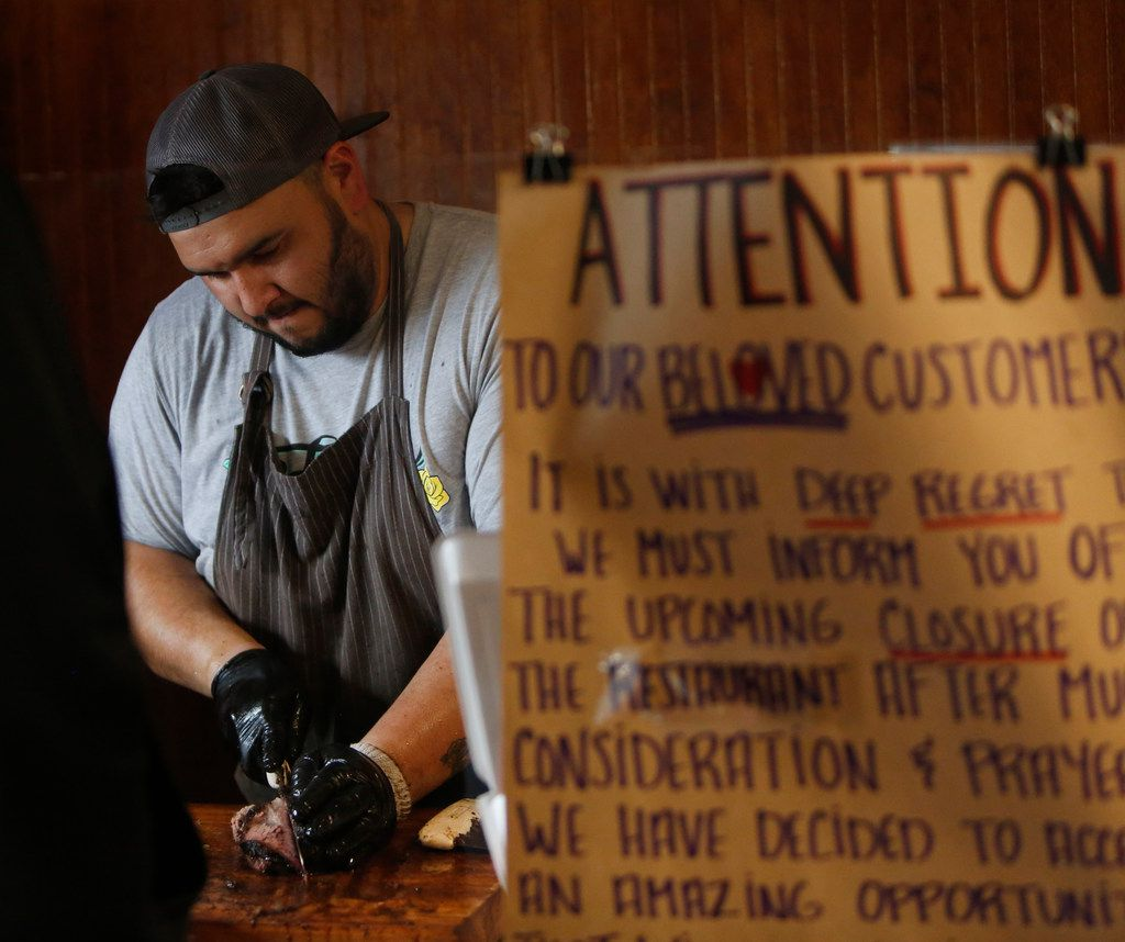 Michael Wyont, pitmaster and owner of Flores Barbecue, slices brisket on its final weekend of operating in Whitney, Texas. Wyont will be re-locating the business to Fort Worth.