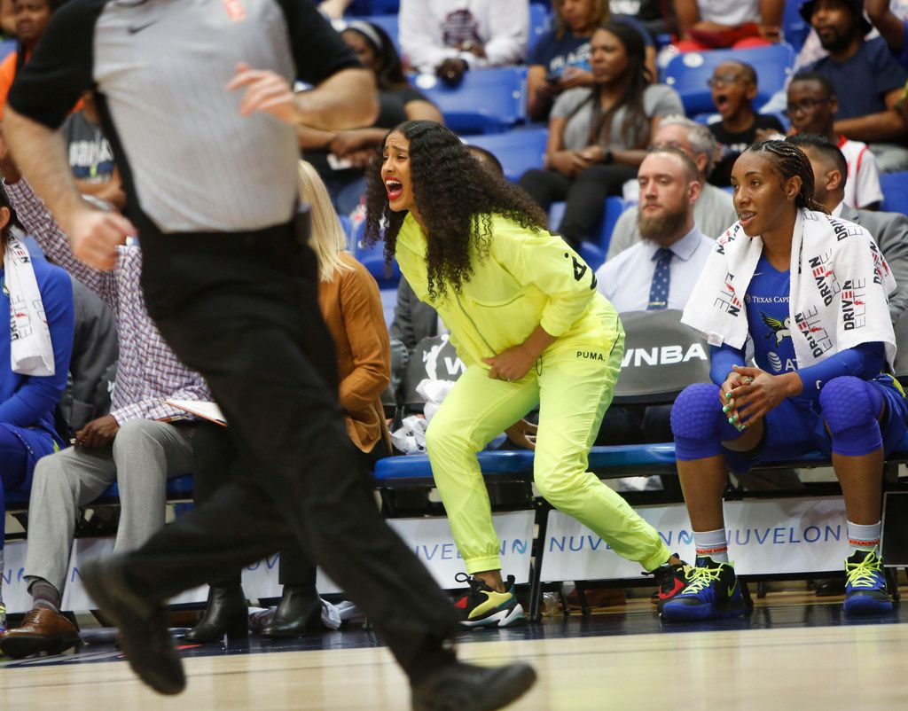 Dallas Wings guard Skylar Diggins-Smith doesn't have to be in the starting lineup to be in the game as she exhibits vocal support from the team bench during first half action of their game against New York Liberty. The Wings defeated Liberty by the score of 87-64. Also pictured on the team bench is forward Kayla Thornton (6). The two teams played their WNBA game at College Park Center in Arlington on August 1, 2019. (Steve Hamm/ Special Contributor)