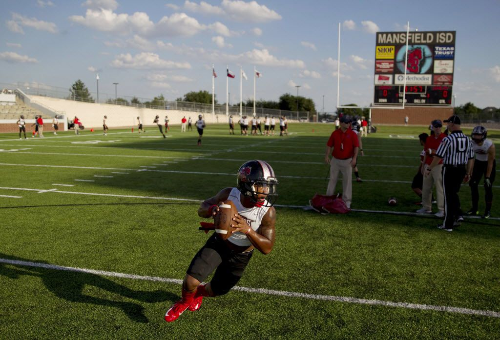 A Mansfield Legacy quarterback practices before a high school football game between Lovejoy High School and Mansfield Legacy High School at Vernon Newsom Stadium in Mansfield, Texas Thursday August 28, 2014. (Andy Jacobsohn/The Dallas Morning News)