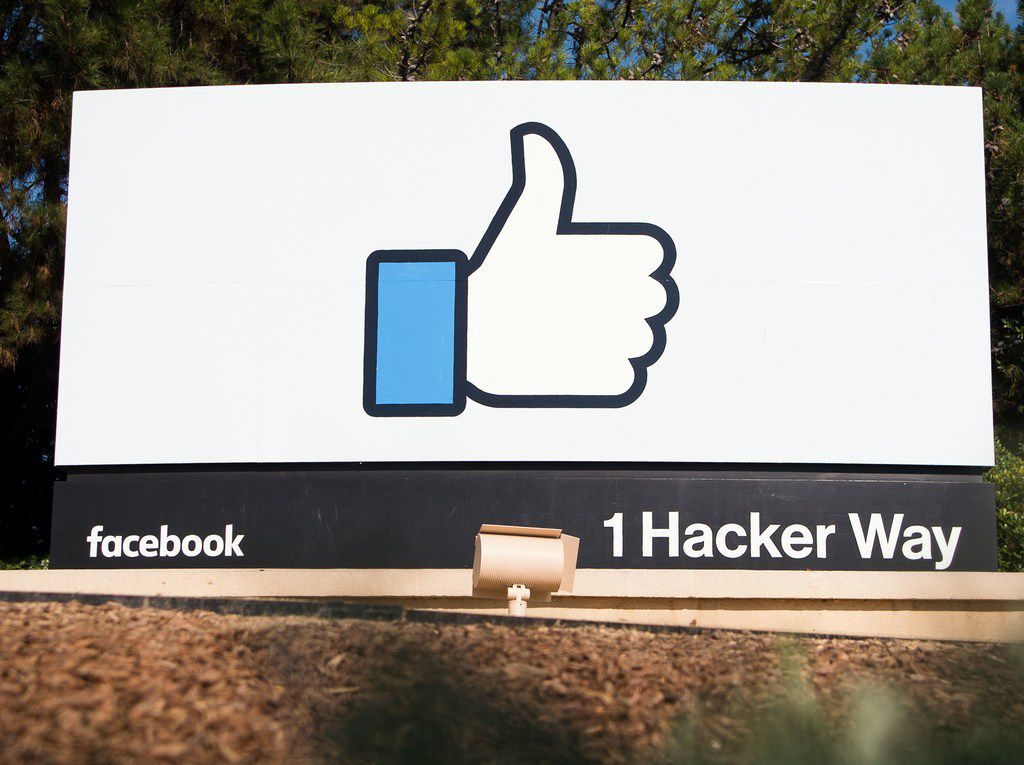 The Facebook sign and logo is seen in Menlo Park, Calif. Facebook has denied allegations that it tried to mislead the public about its knowledge of Russian misinformation ahead of the 2016 presidential election, but severed links with a Republican consultancy.
