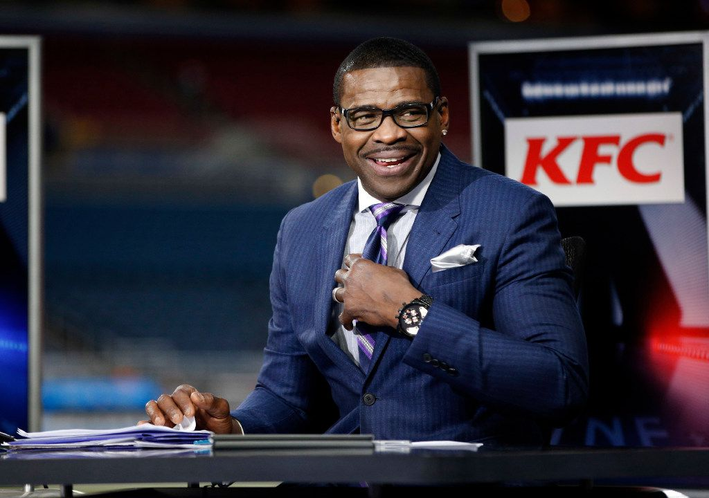 FILE - In this Dec. 17, 2015, file photo, Michael Irvin takes part in the NFL Network's Thursday Night Football broadcast before the start of an NFL football game between the St. Louis Rams and the Tampa Bay Buccaneers in St. Louis. An attorney says a completed police investigation in Florida shows former NFL star Michael Irvin is innocent of sexual battery claims made by a female acquaintance. Irvin's lawyer Kenneth Padowitz said at a news conference Tuesday, June 13, 2017,  that prosecutors should drop the case after reviewing the police investigation. Irvin told reporters the evidence backs up his contention that nothing improper happened. (AP Photo/Billy Hurst, File)