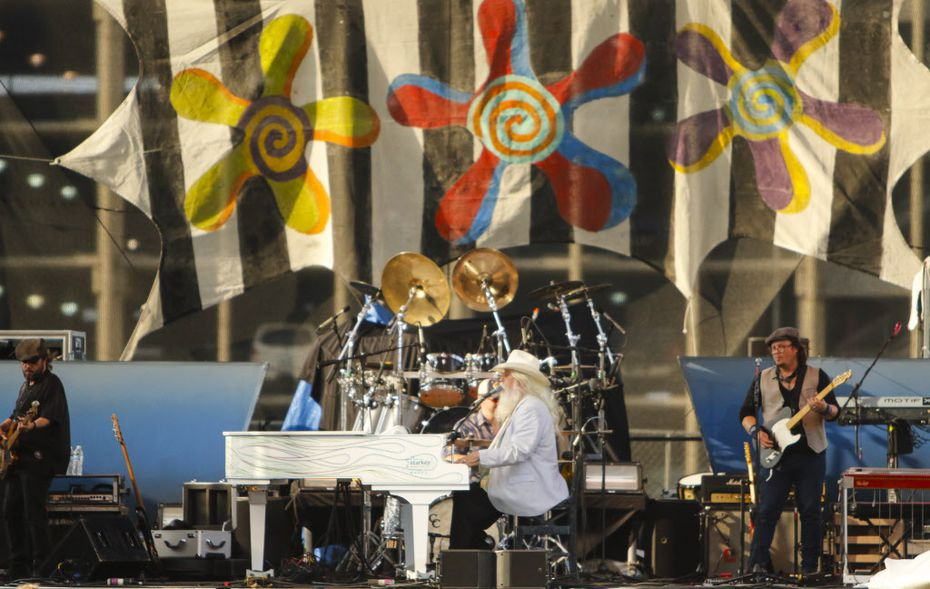 Singer Leon Russell (center) plays the piano and sings during his performance on the Amphitheater Stage at the Wildflower! Arts & Music Festival in Richardson, TX on Saturday, May 16, 2015.