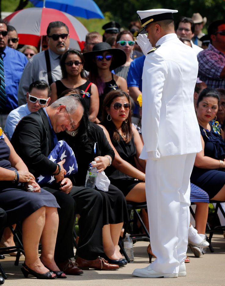 Enrique Zamarripa is overcome with emotion as Navy Lt. Frederick Wood of NAS Joint Reserve Base in Fort Worth salutes him during the U.S. flag presentation in honor of his son, Navy Master-at-Arms 1st Class and Dallas police officer Patrick Zamarripa at Dallas Fort Worth National Cemetery in Dallas, Saturday, July 16, 2016. Zamarripa was gunned down in an ambush attack in downtown Dallas a week ago. Four Dallas police officers and one DART officer were killed and several survived. (Tom Fox/The Dallas Morning News)