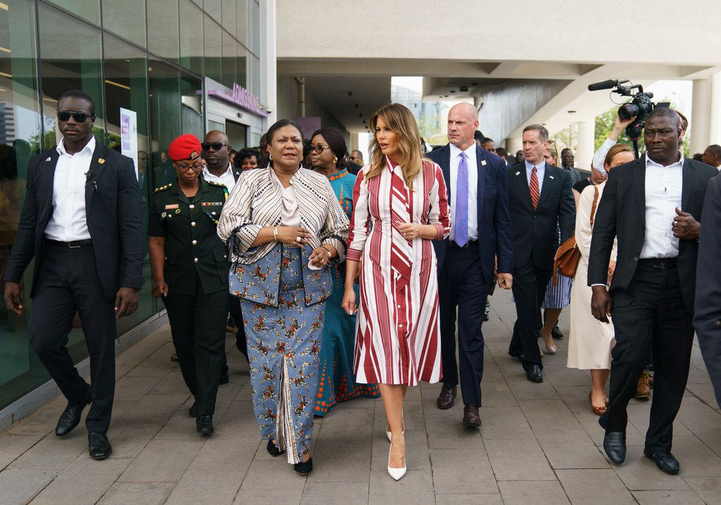 First lady Melania Trump and Ghana's first lady Rebecca Akufo-Addo walk to their vehicles as they leave Greater Accra Regional Hospital in Accra, Ghana, on Oct. 2, 2018. Trump is visiting Africa on her first big solo international trip, aiming to make child well-being the focus of a five-day, four-country tour.