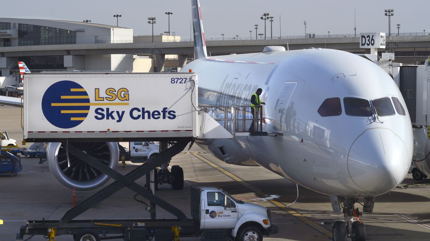 An employee of LSG Sky Chefs prepares to load food and drinks onto an American Airlines commercial jet being serviced at a gate at DFW International Airport. LSG Sky Chefs is the brand name of LSG Lufthansa Service Holding AG, the world's largest provider of airline catering and in-flight services. It is a subsidiary of Deutsche Lufthansa AG. (Photo by Robert Alexander/Getty Images)