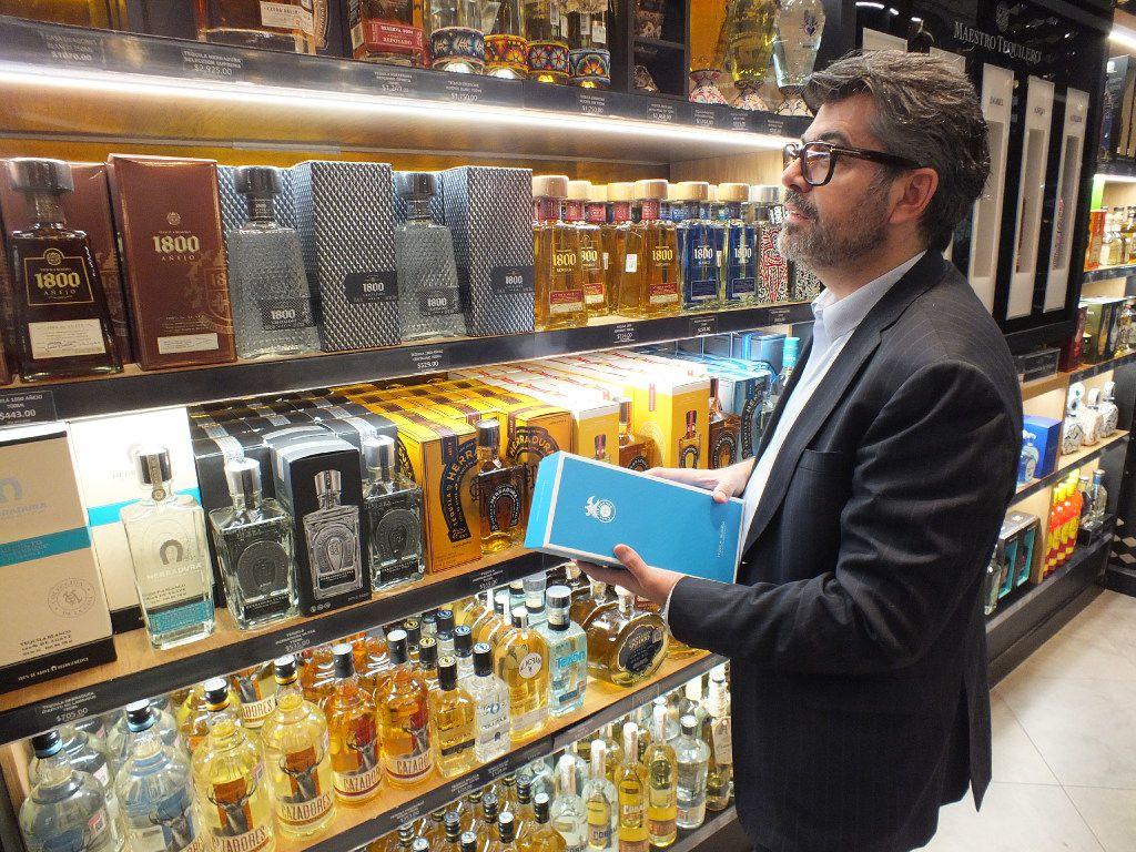 Marketing director Carlos Salcido inspects the expansive collection of tequilas for sale at El Palacio de Hierro's Polanco store.