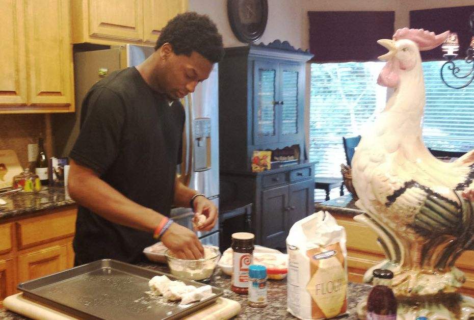Johnson helped prepare a meal in the the Stephensons' kitchen in 2014. (Stephenson family)