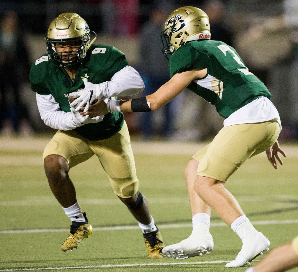 Birdville quarterback Stone Earle (3) hands off the ball to running back Laderrious Mixon (9) during the second half of a high school football game between Birdville and Fort Worth Boswell on Thursday, November 15, 2018 at the Birdville Fine Arts Center in North Richland Hills, Texas. Mixon was taken in by Earle's family. (Ashley Landis/The Dallas Morning News)