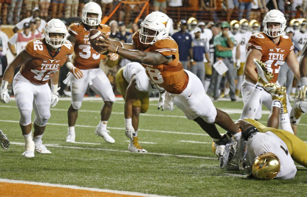 Texas quarterback Tyrone Swoopes (18) scores the winning touchdown in the second overtime during the Notre Dame Fighting Irish vs. the University of Texas Longhorns NCAA football game at Darrell K. Royal Memorial Stadium in Austin on Sunday, September 4, 2016. (Louis DeLuca/The Dallas Morning News)