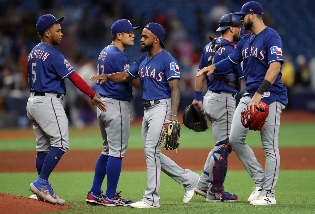 Members of the Texas Rangers celebrate a 5-0 win over the Tampa Bay Rays in a baseball game Friday, June 28, 2019, in St. Petersburg, Fla. (AP Photo/Mike Carlson)