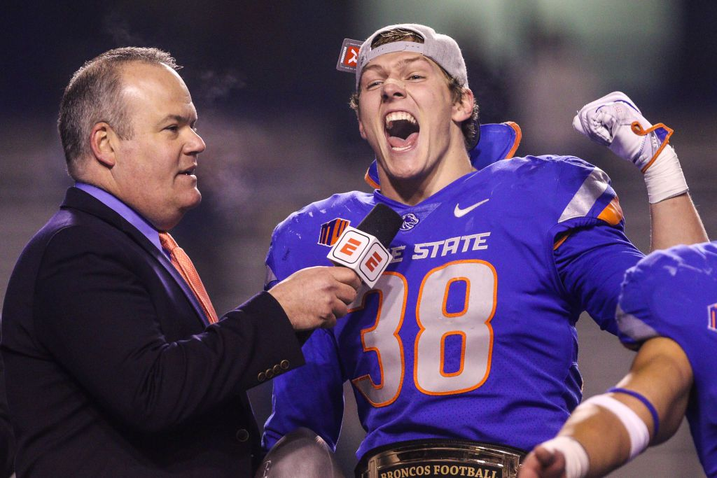 BOISE, ID - DECEMBER 2: Linebacker Leighton Vander Esch #38 of the Boise State Broncos, the Mountain West Defensive Player of the game, talks with Jesse Kurtz at the conclusion of the Mountain West Championship against the Fresno State Bulldogs on December 2, 2017 at Albertsons Stadium in Boise, Idaho. Boise State won the game 17-14. (Photo by Loren Orr/Getty Images)