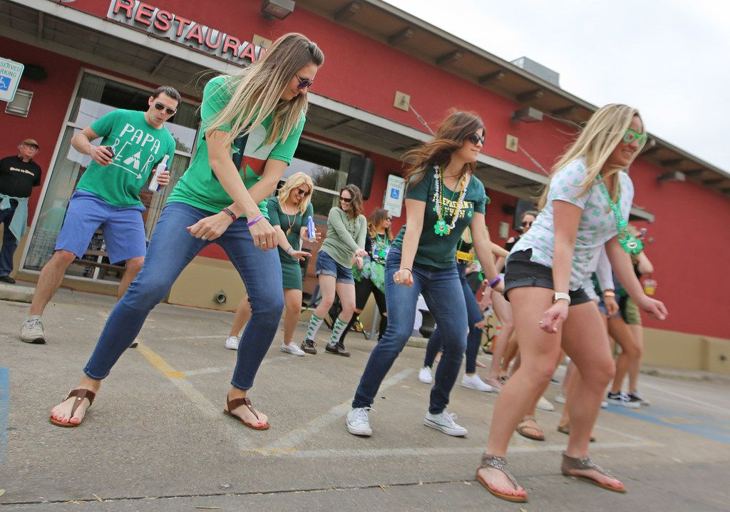 The parking lot of Gloria's becomes a dance floor for revelers after the parade during the Dallas St. Patrick's Parade & Festival along Greenville Avenue in Dallas on Saturday.