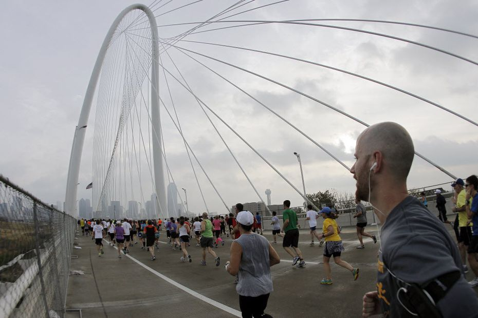 Runners head east across the Margaret Hunt Hill Bridge during the MetroPCS Dallas Marathon in Dallas, Saturday, December 9, 2012.